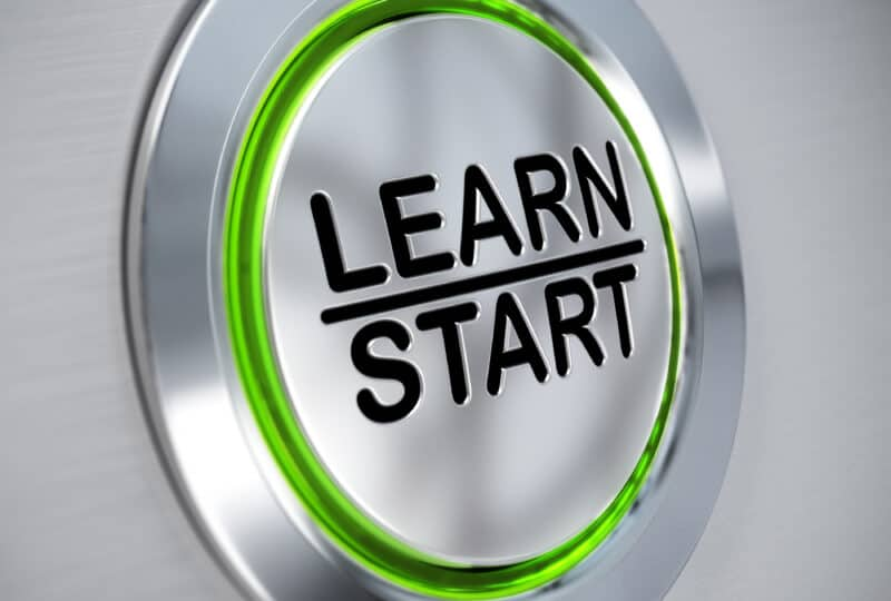 a close up of a button with learn start written on it