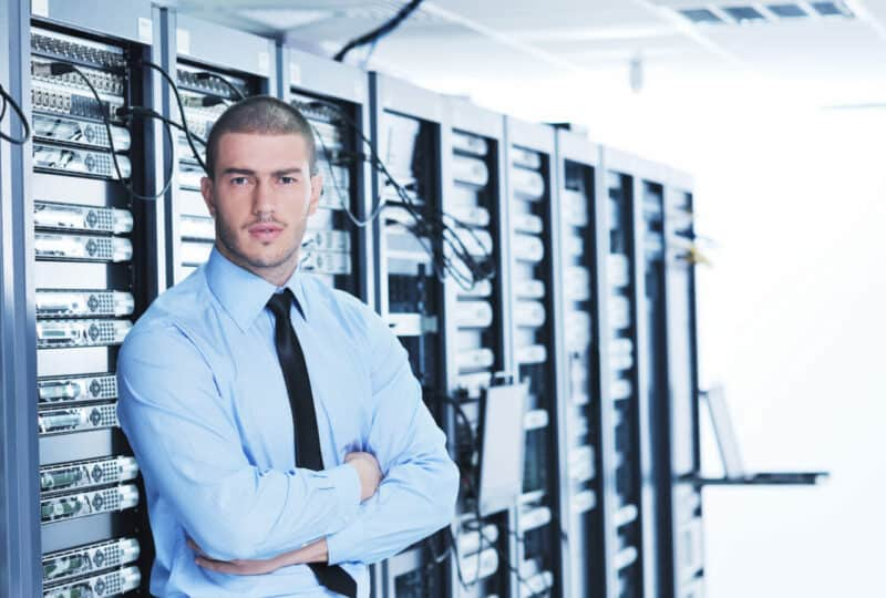 man standing in a datacenter server room