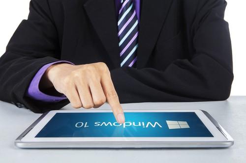 JAKARTA, SEPTEMBER 02, 2015: Closeup of businessman finger using a digital tablet with software of windows 10