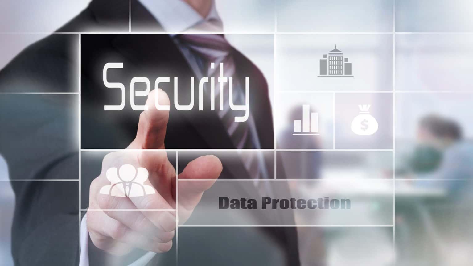 Businessman pressing a security concept button.