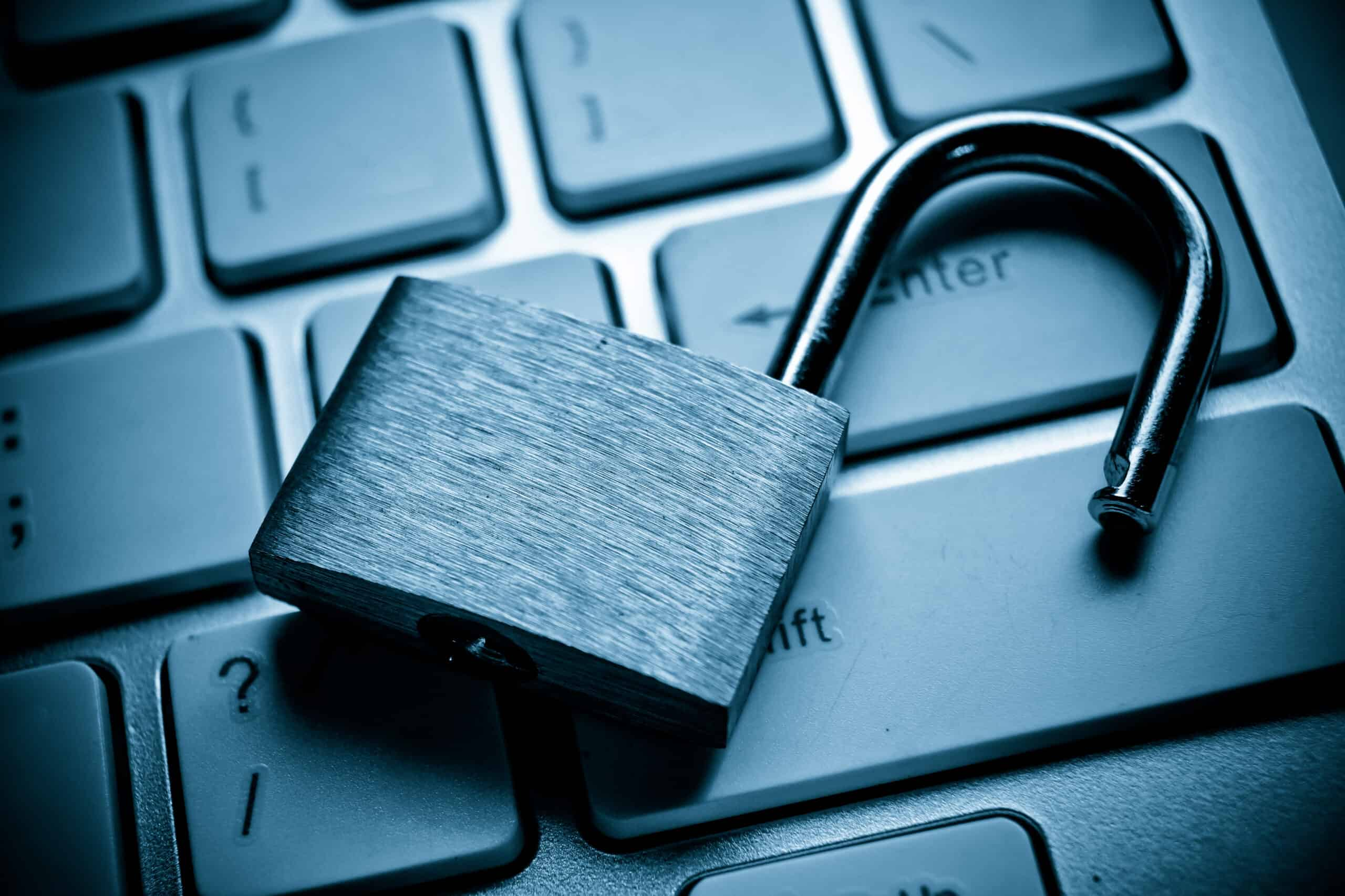 a close up of a padlock sitting on top of a laptop keyboard