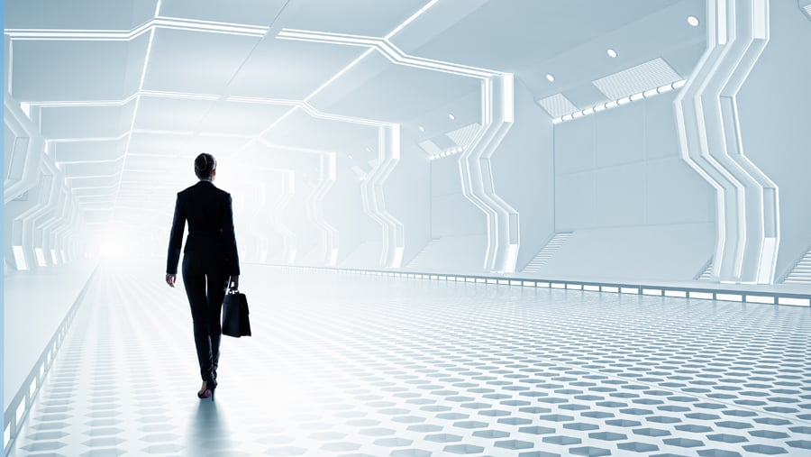 Businesswoman standing in virtual designed tunnel room