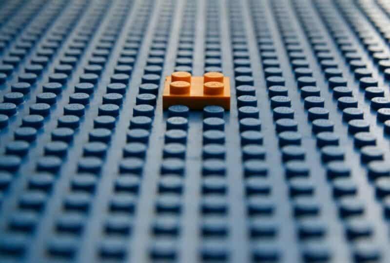 lego brick fitting into a lego board